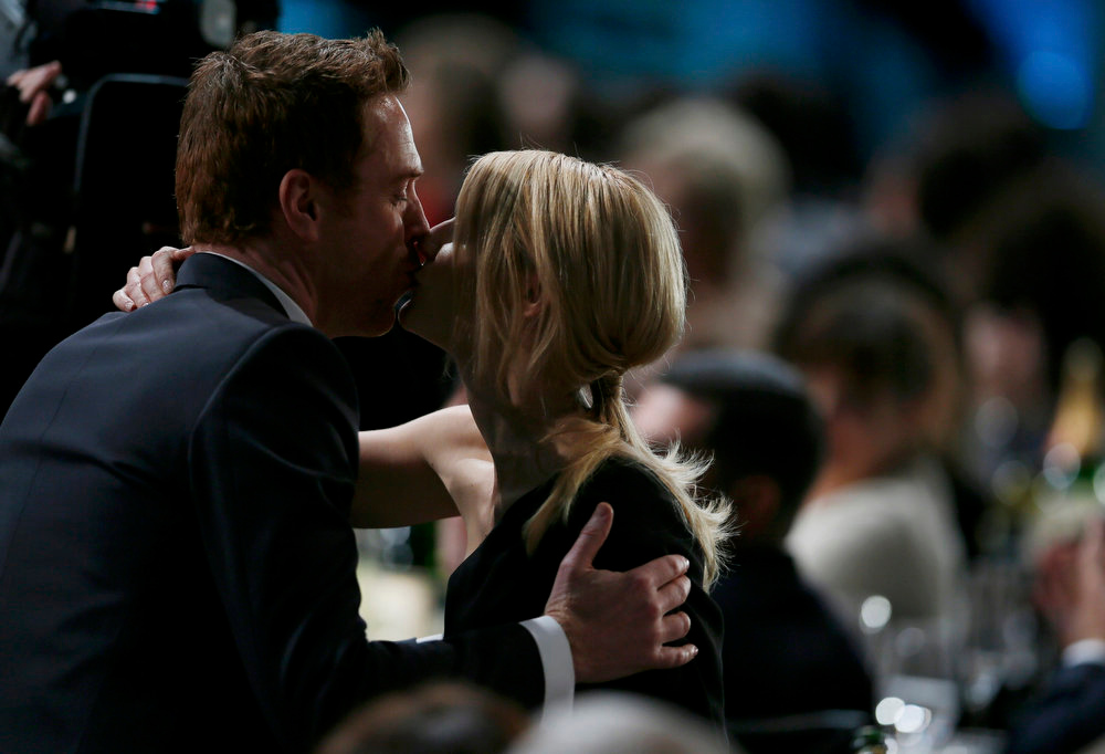 ". Claire Danes is congratulated by co-star Damien Lewis as she prepares to accept the award for outstanding female actor in a drama series for ""Homeland\"" at the 19th annual Screen Actors Guild Awards in Los Angeles, California January 27, 2013.   REUTERS/Lucy Nicholson"