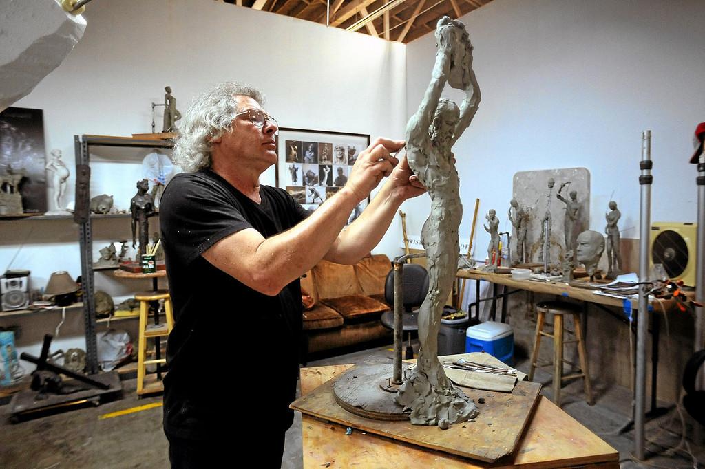 . Glassel Park sculptor Christopher Slatoff works in his studio September 4, 2013.(Andy Holzman/Los Angeles Daily News)