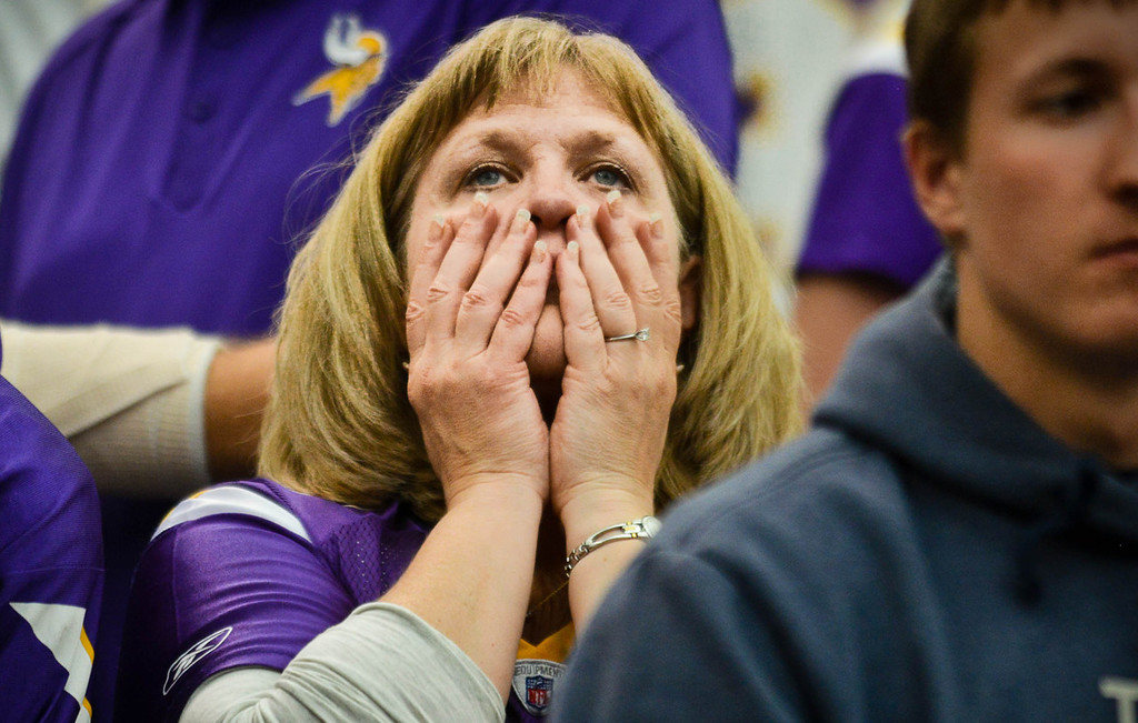 . A fan reacts as the Vikings try and fail to score in the final seconds of their 31-27 loss to Cleveland.  (Pioneer Press: Ben Garvin)