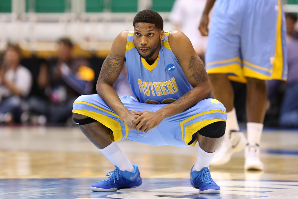 . SALT LAKE CITY, UT - MARCH 21:  Brandon Moore #32 of the Southern University Jaguars kneels down in the first half while taking on the Gonzaga Bulldogs during the second round of the 2013 NCAA Men\'s Basketball Tournament at EnergySolutions Arena on March 21, 2013 in Salt Lake City, Utah.  (Photo by Streeter Lecka/Getty Images)
