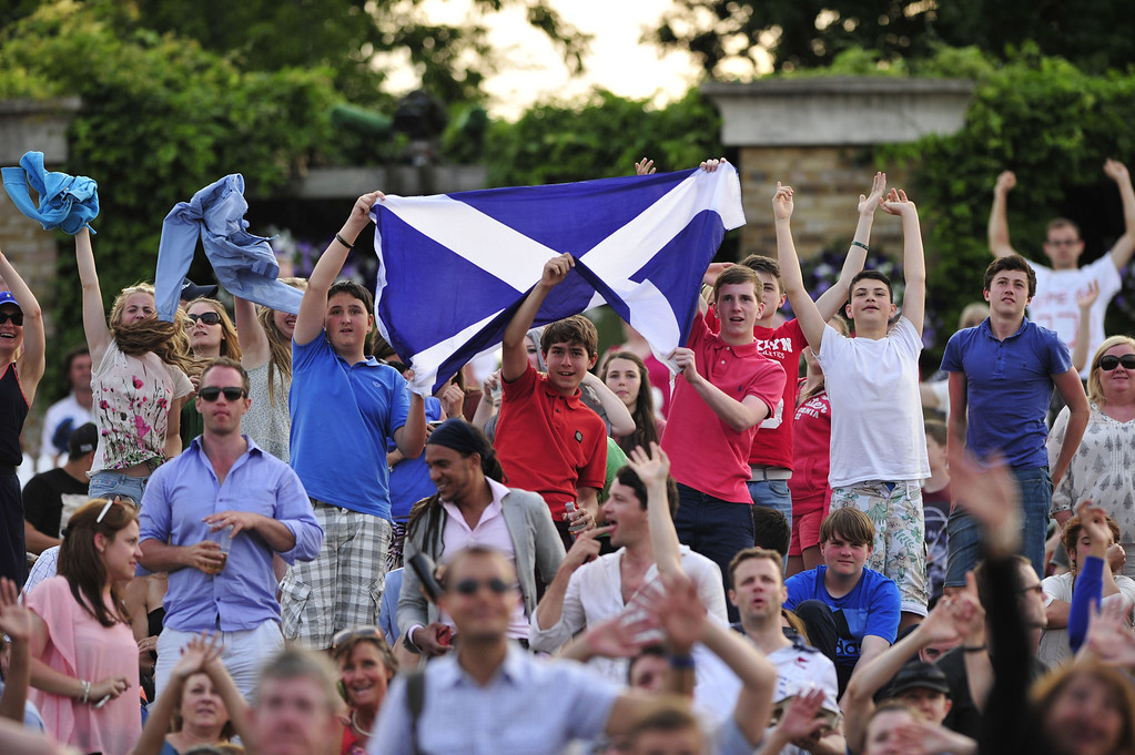 . Tennis fans hold up a Scottish flag as they watch on the big screen at Murray Mount Britain\'s Andy Murray play against Poland\'s Jerzy Janowicz in their men\'s singles semi-final match on day eleven of the 2013 Wimbledon Championships tennis tournament at the All England Club in Wimbledon, southwest London, on July 5, 2013. GLYN KIRK/AFP/Getty Images