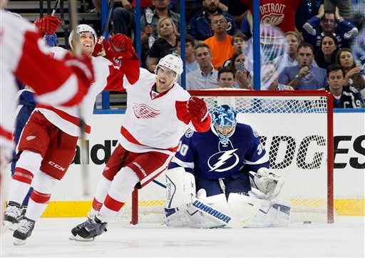 . Detroit Red Wings right wing Luke Glendening, left, celebrates his goal against Tampa Bay Lightning goalie Ben Bishop (30), next to Red Wings center Joakim Andersson during the third period of Game 1 of an NHL hockey first-round playoff series, Thursday, Aprill 16, 2015, in Tampa, Fla. The Red Wings won 3-2. (Dirk Shadd/Tampa Bay Times via AP)