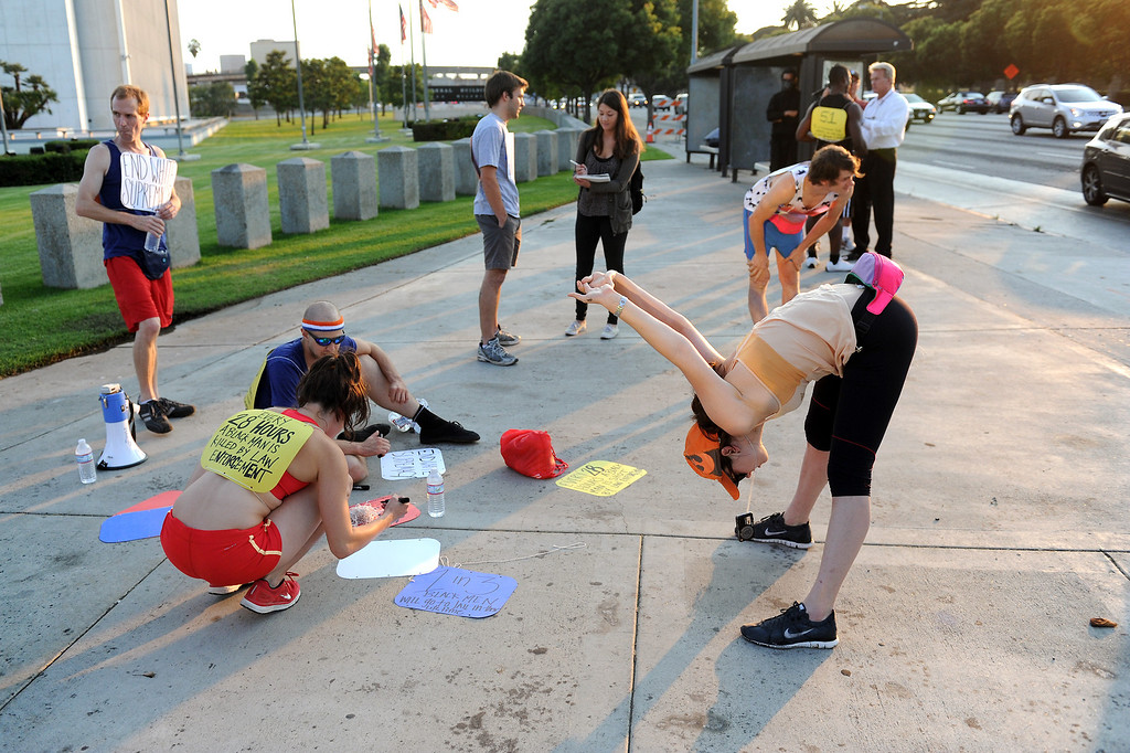 """. Protesters warmup on Wilshire Boulevard before jogging through Westwood on a \""""Smash White Supremacy Fun Run,\"""" Thursday, July 18, 2013. (Michael Owen Baker/L.A. Daily News)"""