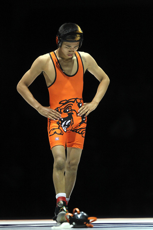 . Vacaville\' Gionn Peralta reacts after losing to Central\'s Adrian Composano in the 106-pound championship match during the California Interscholastic Federation wrestling championships in Bakersfield, Calif., on Saturday, March 2, 2013. Composano won the match 11-10. (Anda Chu/Staff)