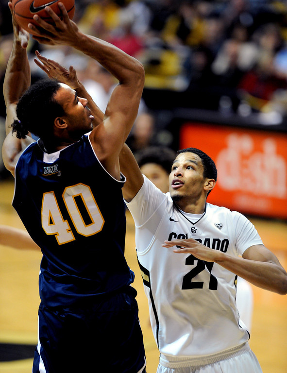 . Northern Arizona\'s Ben Olayinka (40) tries to shoot over Colorado\'s Andre Roberson during the first half of an NCAA college basketball game on Friday, Dec. 21, 2012, in Boulder, Colo. (AP Photo/Daily Camera)