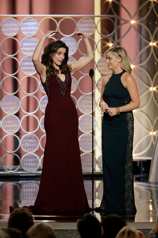 . This image released by NBC shows hosts Tina Fey, left, and Amy Poehler during the 71st annual Golden Globe Awards at the Beverly Hilton Hotel on Sunday, Jan. 12, 2014, in Beverly Hills, Calif. (AP Photo/NBC, Paul Drinkwater)