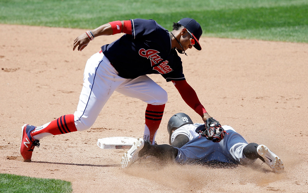 . Cleveland Indians\' Francisco Lindor, top, tags out Chicago White Sox\'s Leury Garcia in the fifth inning of a baseball game, Sunday, June 11, 2017, in Cleveland. (AP Photo/Tony Dejak)