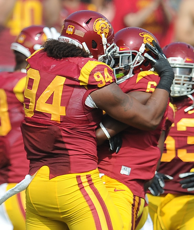 . Southern California safety Josh Shaw (6) reacts with teammate defensive end Leonard Williams (94) after recovering a Utah fumble during the first half of an NCAA college football game in the Los Angeles Memorial Coliseum in Los Angeles, on Saturday, Oct. 26, 2013.  (Photo by Keith Birmingham/Pasadena Star-News)