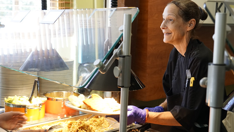 LeeAnn Henderson serving lunch to students on Labor Day.