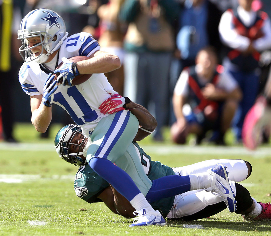. Dallas Cowboys wide receiver Cole Beasley (11) is tackled by Philadelphia Eagles cornerback Brandon Boykin (22) during the first half of an NFL football game, Sunday, Oct. 20, 2013, in Philadelphia. (AP Photo/Matt Rourke)