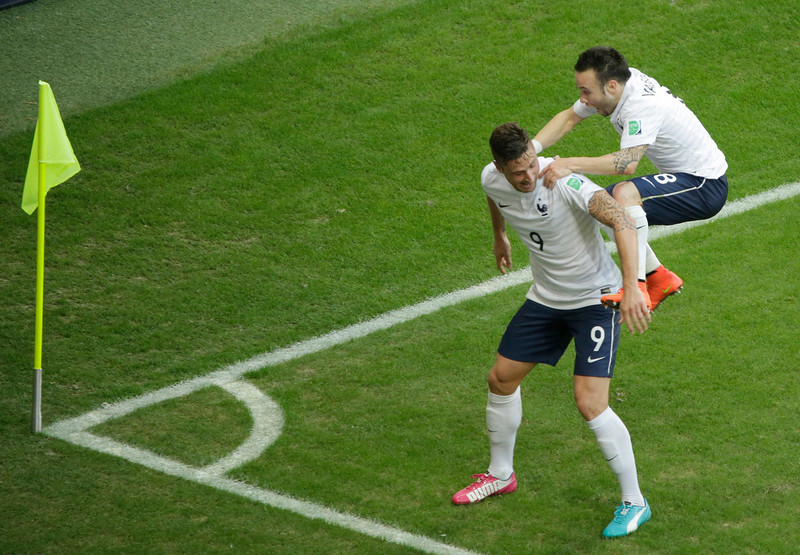 . France\'s Mathieu Valbuena, right, celebrates with his teammate Olivier Giroud after scoring his side\'s third goal during the group E World Cup soccer match between Switzerland and France at the Arena Fonte Nova in Salvador, Brazil, Friday, June 20, 2014. (AP Photo/Sergei Grits)