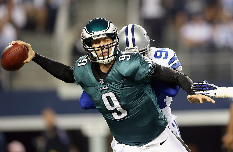 . Nick Foles #9 of the Philadelphia Eagles is hit from behind by  DeMarcus Ware #94 of the Dallas Cowboys at Cowboys Stadium on December 2, 2012 in Arlington, Texas.  (Photo by Ronald Martinez/Getty Images)