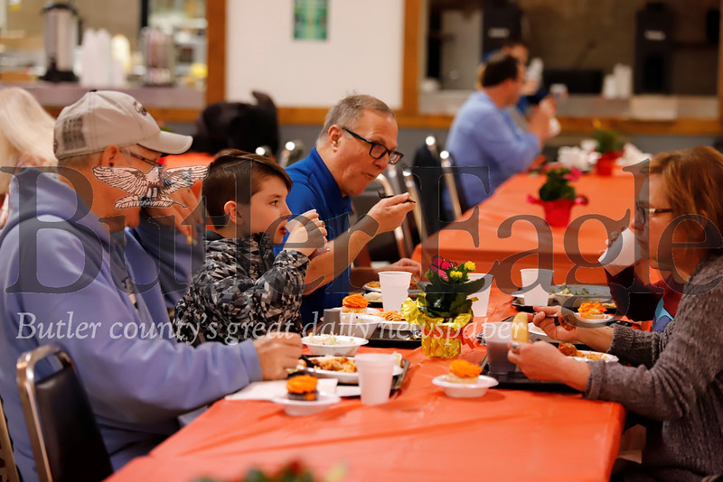 Bo Dickey of South Butler (left) sits down for Wednesday's Spaghetti Dinner fundraiser at Tanglewood with William Fielder, Joe and Suzie Commisa. Seb Foltz/Butler Eagle