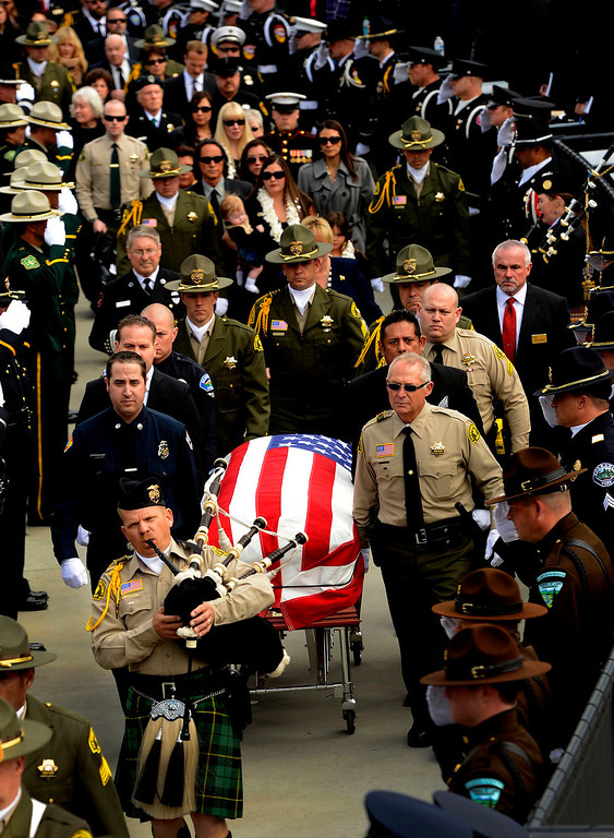 . The procession for San Bernardino County Sheriff Deputy Jeremiah MacKay enters the San Manuel Amphitheater in Devore February 21, 2013.  (Photo by Gabriel Luis Acosta/The Sun)