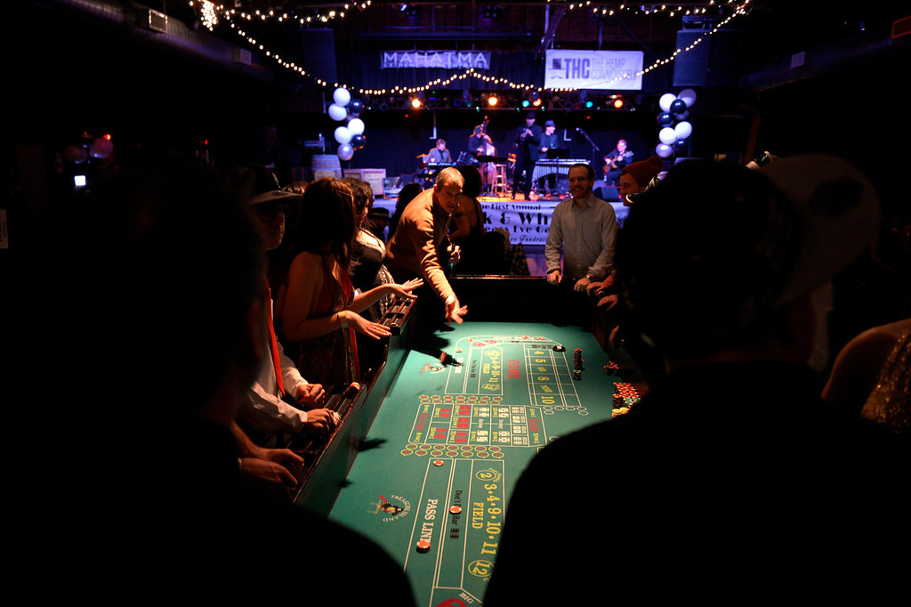 . DENVER, CO. - December 31: The craps table is rolling as guests throw dice at the Prohibition is Over! party at Casselman\'s Bar and Venue by The Hemp Connoisseur & Mahatma Extreme Concentrates December 31, 2013 Denver, CO. (Photo By Joe Amon/The Denver Post)