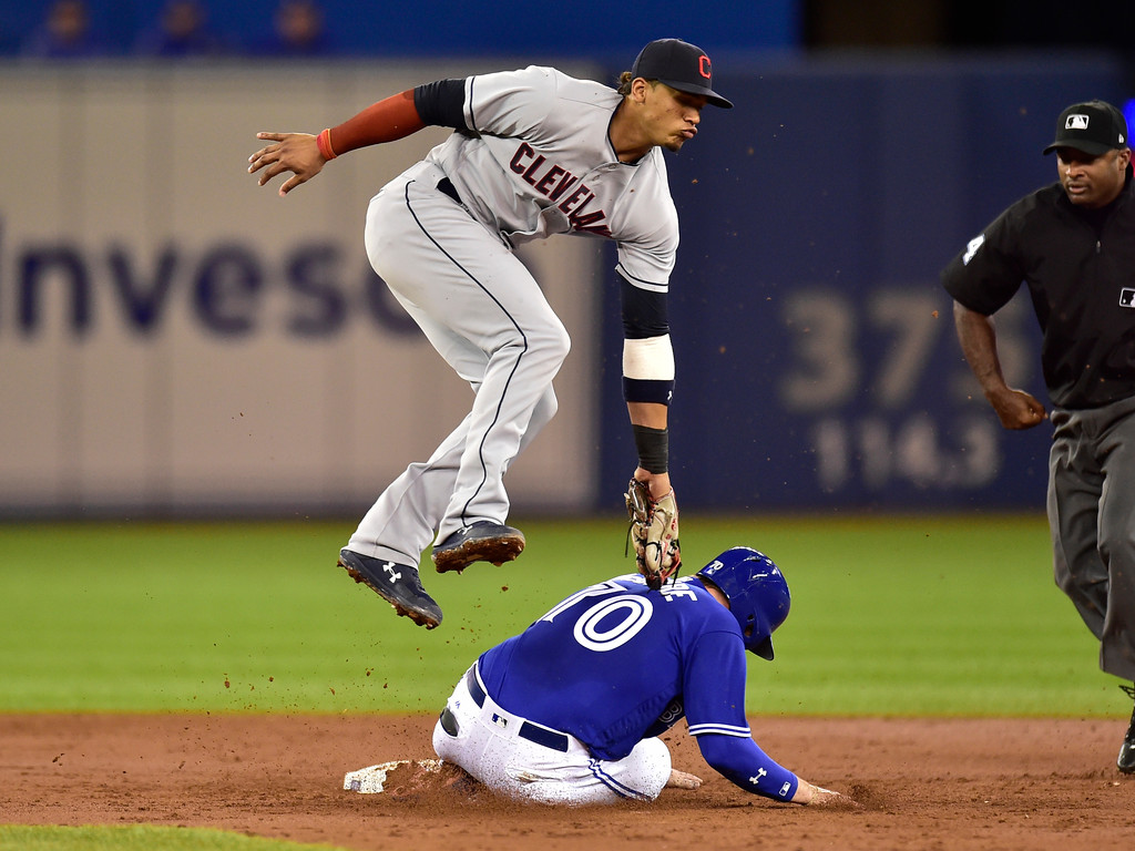 . Toronto Blue Jays Reese McGuire steals second base under the tag of Cleveland Indians second baseman Erik Gonzalez (9) during third inning American League baseball action in Toronto, Sunday, Sept. 9, 2018. (Frank Gunn /The Canadian Press via AP)