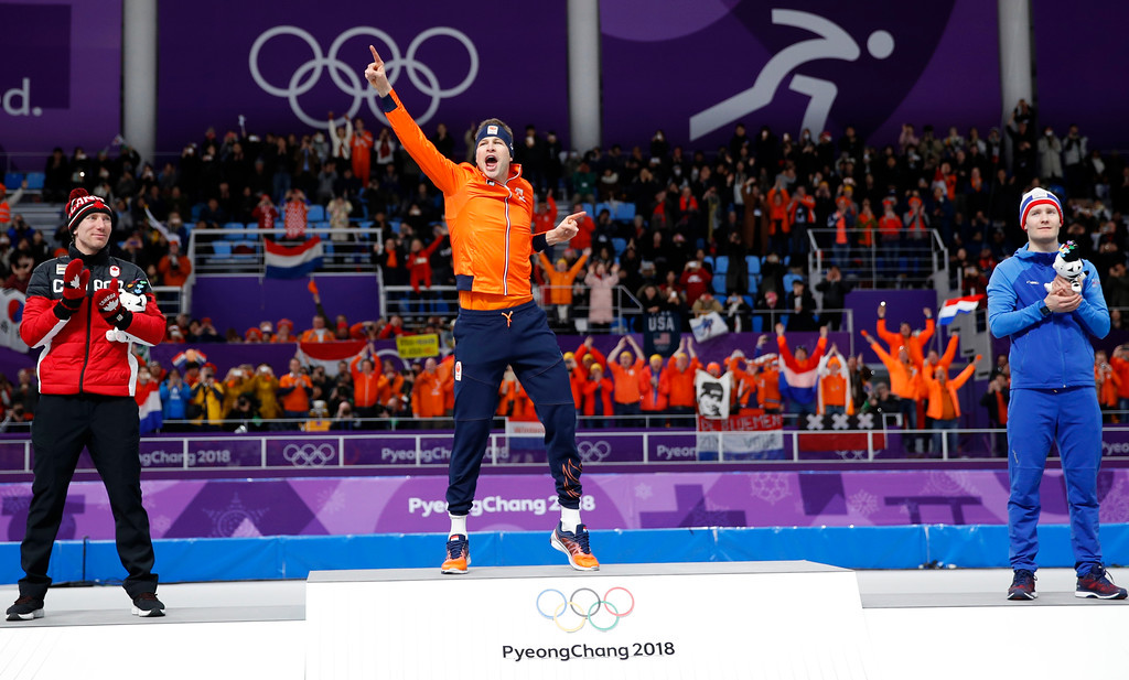 . Gold medallist and new Olympic record holder Sven Kramer of The Netherlands, center, celebrates with silver medallist Ted-Jan Bloemen of Canada, left, and bronze medallist Norway\'s Sverre Lunde Pedersen, right, after the men\'s 5,000 meters race at the Gangneung Oval at the 2018 Winter Olympics in Gangneung, South Korea, Sunday, Feb. 11, 2018. (AP Photo/Vadim Ghirda)