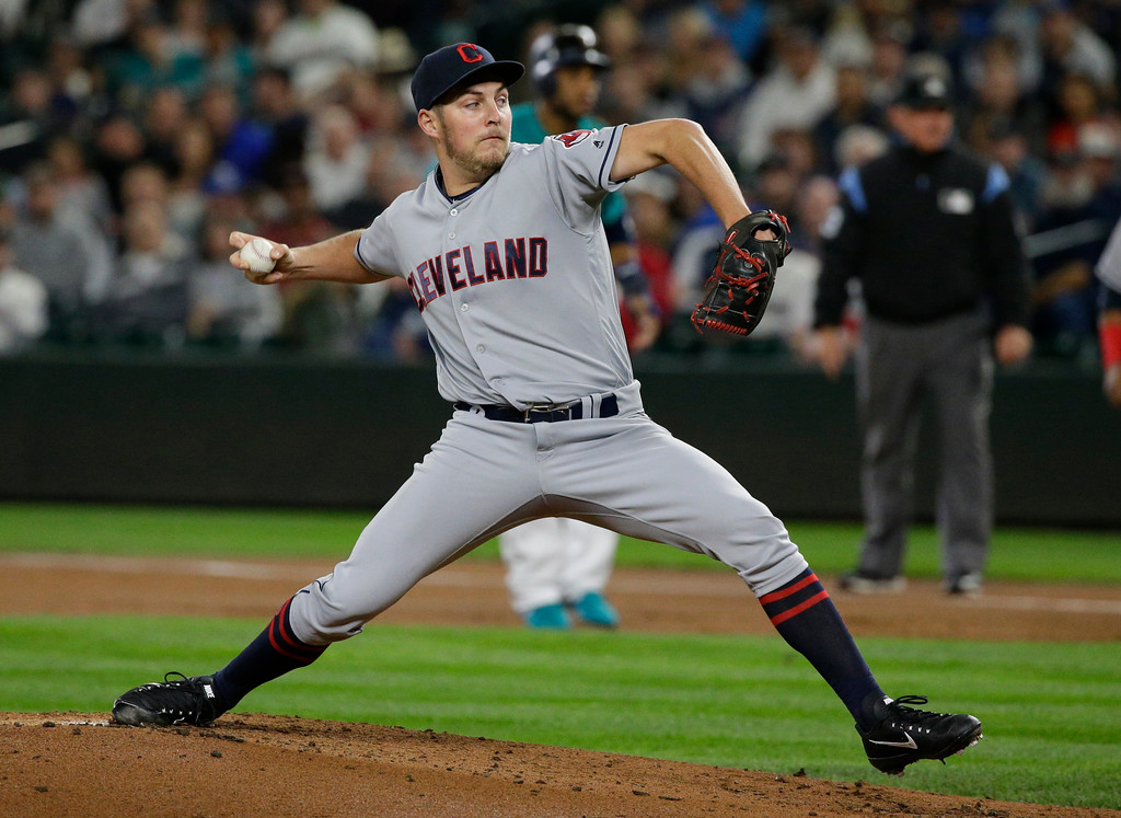 . Cleveland Indians starting pitcher Trevor Bauer throws to a Seattle Mariners batter during the first inning of a baseball game, Friday, Sept. 22, 2017, in Seattle. (AP Photo/Ted S. Warren)