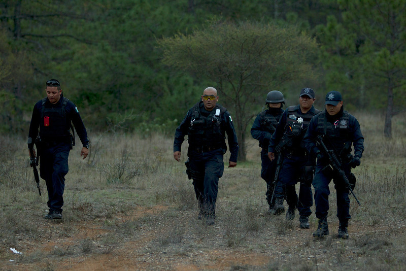 . Federal police officers return from the crash site where a plane allegedly carrying U.S-born singer Jenni Rivera crashed near Iturbide, Mexico Sunday Dec. 12, 2012. The wreckage of a small plane believed to be carrying Jenni Rivera, the U.S-born singer whose soulful voice and unfettered discussion of a series of personal travails made her a Mexican-American superstar, was found in northern Mexico on Sunday. Authorities said there were no survivors. (AP Photo/Hans Maximo Musielik)