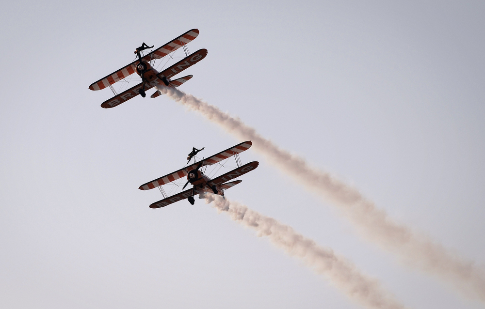 . Breitling Wingwalkers display team perform during the opening of the Bahrain International Airshow 2014, in Sakhir, south of the capital Manama, on January 16, 2014. (MOHAMMED AL-SHAIKH/AFP/Getty Images)