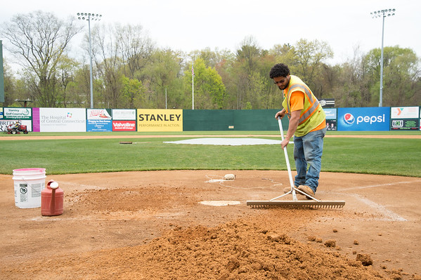 05/02/19 Wesley Bunnell | Staff Work at New Britain Stadium is underway getting the field in shape for Friday's upcoming New Britain Bees home opener. New Britain Public Works employee Alberto Vega spends time working around the home plate area.