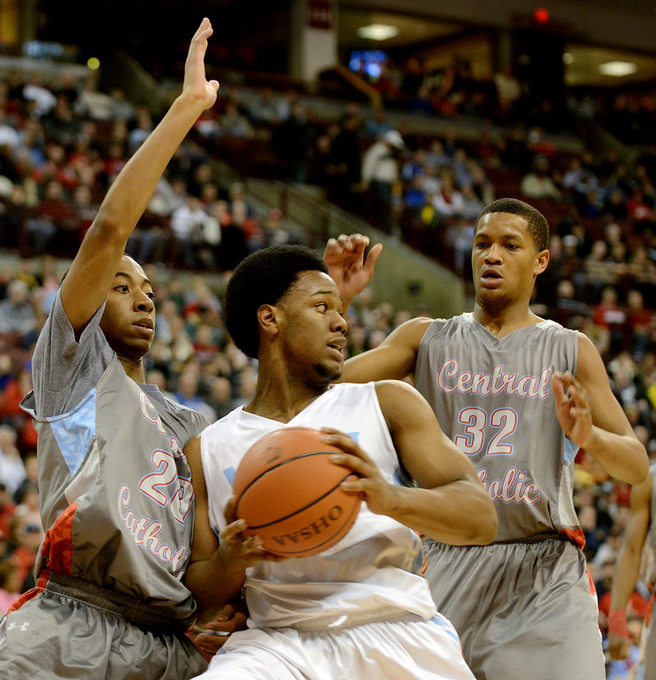 . Duncan Scott/DScott@News-Herald.com VASJ\'s Brian Parker is defended by Martyce Kimbrough, left, and Dantez Walton during VASJ\'s 64-62 loss to Lima Central Catholic in the Division III state championship game on March 22 in the Value City Arena in the  Schottenstein Center in Columbus.