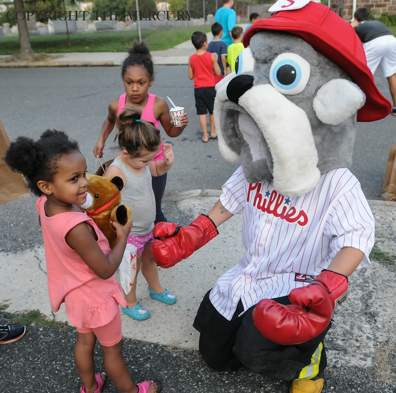 . Kids visit with Phillies Fire Co. mascot Fire plug at First Church of the Brethren at Fifth and York street as part of the National Night Out events held in Pottstown. Photo by John Strickler The Mercury