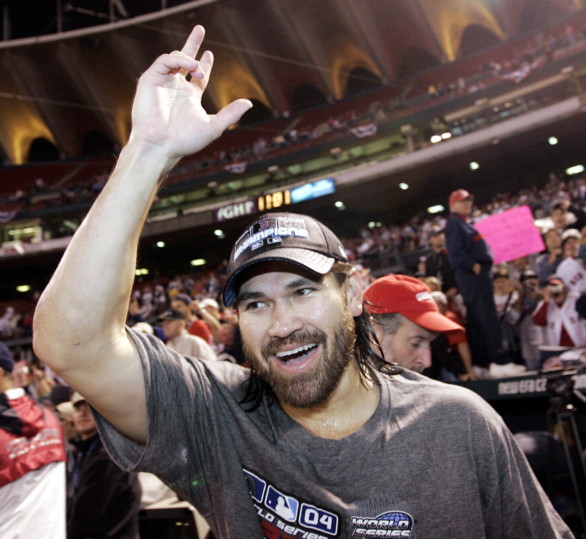 . Boston Red Sox\'s Johnny Damon waves to fans as he comes back on the field after the Red Sox swept the World Series with a 3-0 win over the St. Louis Cardinals, Wednesday Oct. 27, 2004, in St. Louis. (AP Photo/Sue Ogrocki)