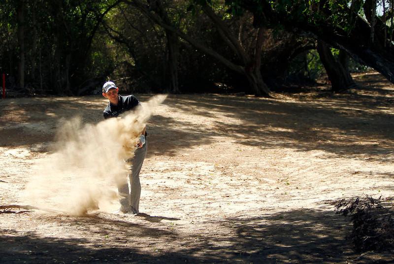 . Stephen Gallacher of Scotland plays a ball on the dirt on the 2nd hole during the final round of the Dubai Desert Classic Golf tournament in Dubai, United Arab Emirates, Sunday, Feb. 3, 2013. (AP Photo/Kamran Jebreili)