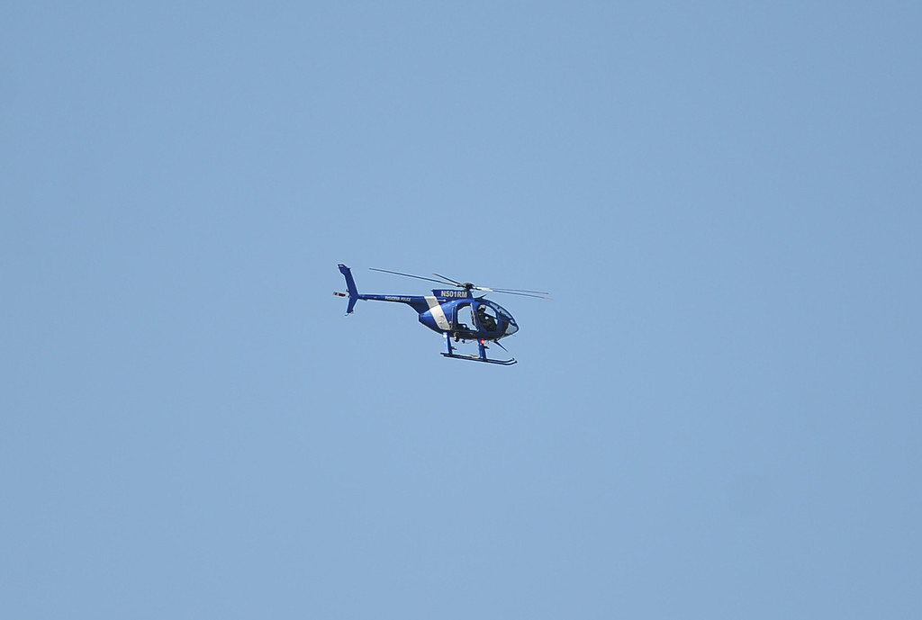 . A police helicopter circles the campus after a lockdown at Arcadia High School in Arcadia, Calif. on Thursday, Sept. 12, 2013.   (Photo by Keith Birmingham/Pasadena Star-News)