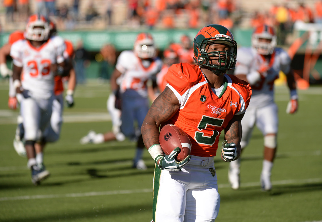 . FORT COLLINS, CO - September 28 : RB Kapri Bibbs of Colorado State University (5) rushes for a touchdown in the 4th quarter of the game against University of Texas at El Paso at Hughes Stadium. Fort Collins, Colorado. September 28, 2013. CSU won 59 - 42. (Photo by Hyoung Chang/The Denver Post)