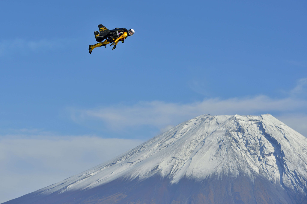 ". This handout picture taken near Fujinomiya in Shizuoka prefecture on October 30, 2013 and released on November 6, 2013 shows Swiss pilot Yves Rossy, or ""Jetman\"", flying near Mount Fuji.    AFP PHOTO / Breitling SA & JETMAN PROJECT / KATSUHIKO TOKUNAGA /AFP/Getty Images"