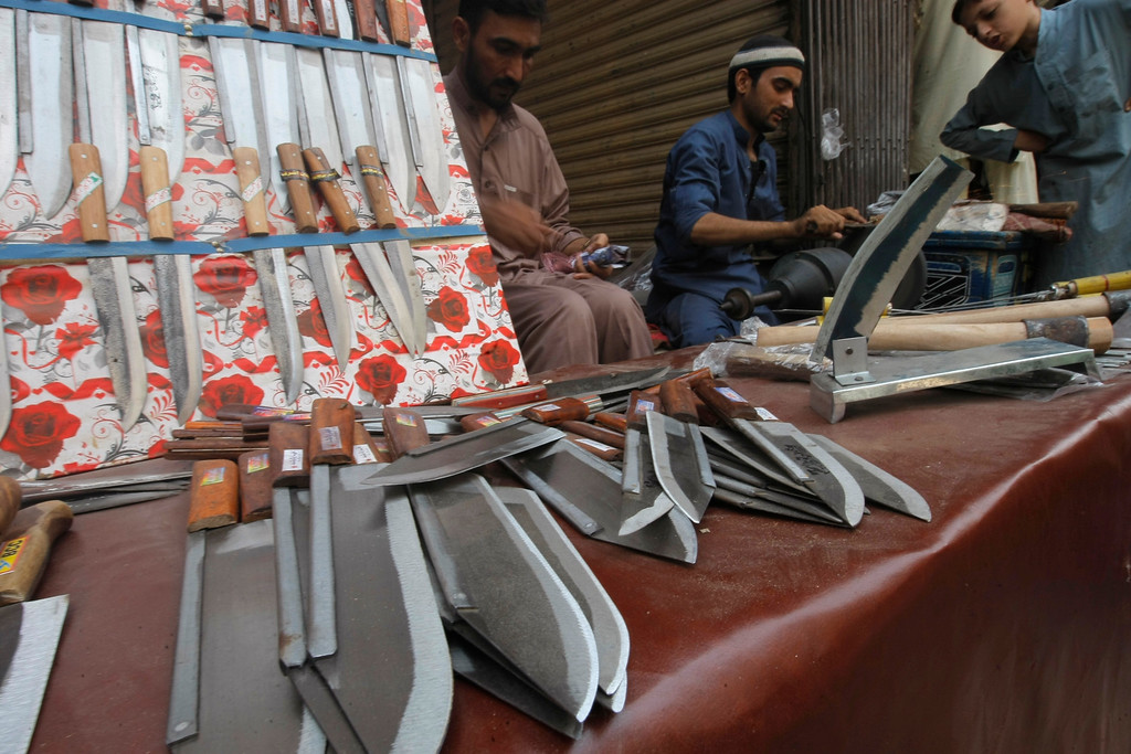 . A Pakistani vendor sharpens customers\' knives for the upcoming Muslim holiday of Eid al-Adha, in Peshawar, Pakistan, Monday, Sept.12, 2016. Pakistanis will celebrate the Eid al-Adha, or the Feast of the Sacrifice, on Tuesday to mark the willingness of the Prophet Ibrahim -- Abraham to Christians and Jews -- to sacrifice his son. During the holiday Muslims slaughter sheep and cattle, distribute part of the meat to the poor and eat the rest. (AP Photo/Mohammad Sajjad)