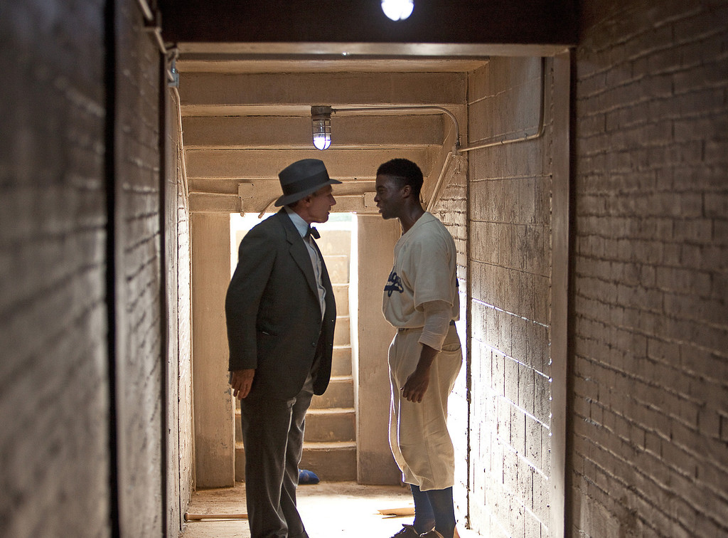 ". This film image released by Warner Bros. Pictures shows Chadwick Boseman as Jackie Robinson, right, and Harrison Ford as Branch Rickey in a scene from ""42.\"" (AP Photo/Warner Bros. Pictures, D. Stevens)"