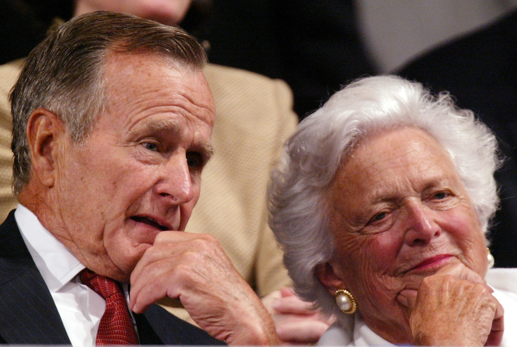 . Former President George H.W. Bush and former first lady Barbara Bush listen as, President Bush, accepts the party nomination at the Republican National Convention Thursday, Sept.2, 2004, in New York. (AP Photo/Paul Sancya)