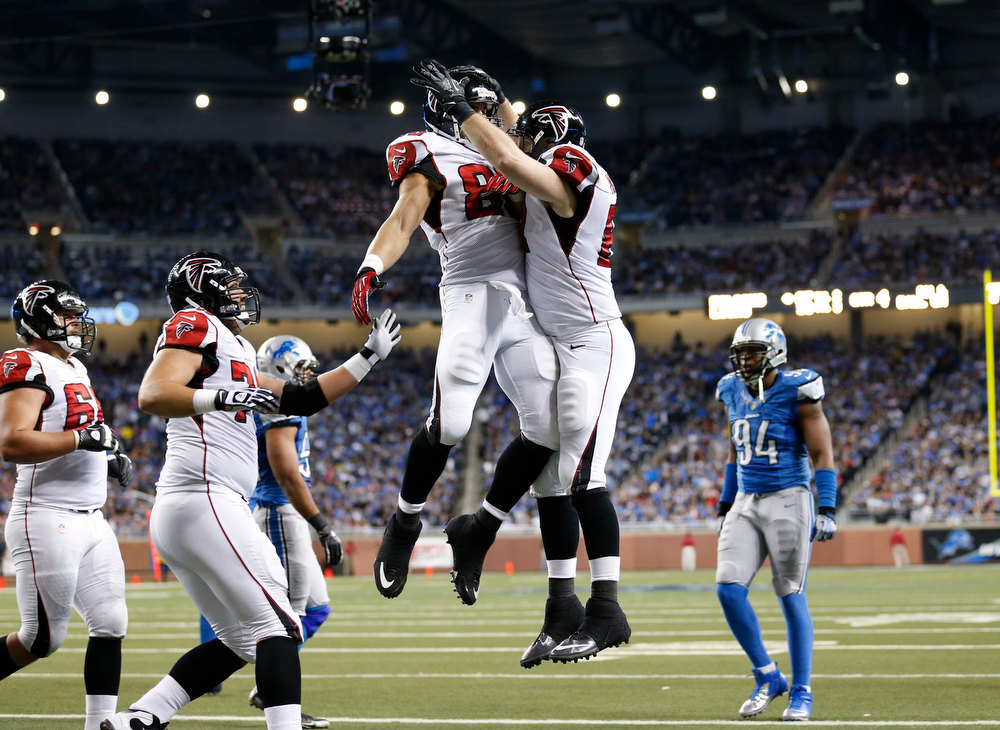 Description of . Atlanta Falcons tight end Michael Palmer, center right, celebrates his touchdown with tight end Tony Gonzalezduring the fourth quarter of an NFL football game against the Detroit Lions at Ford Field in Detroit, Saturday, Dec. 22, 2012. (AP Photo/Rick Osentoski)