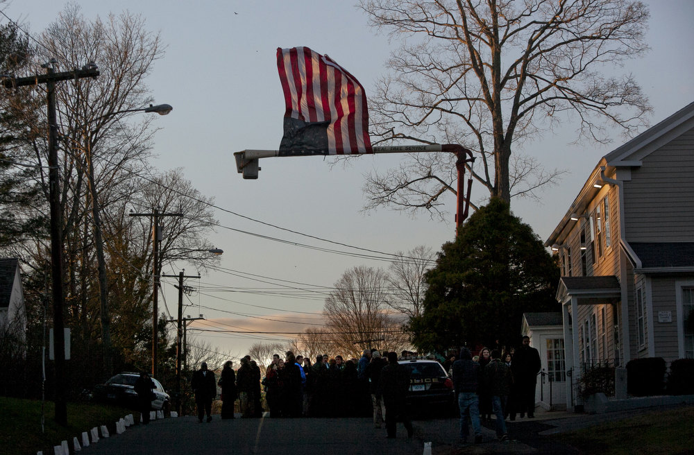 . Mourners lineup for the wake of school principal Dawn Hochsprung, December 19, 2012 in Woodbury, Connecticut. Six victims of the Newtown school shooting are being honored at funerals and visitations across the state today for the victims of Sandy Hook Elementary School. (Photo by Allison Joyce/Getty Images)