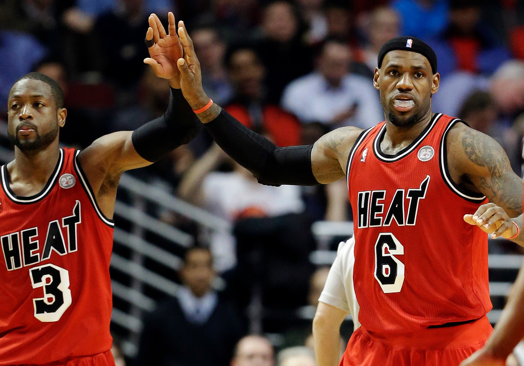 . Miami Heat forward LeBron James (6) celebrates with guard Dwyane Wade after scoring against the Chicago Bulls during the second half of an NBA basketball game in Chicago, Thursday, Feb. 21, 2013. The Heat won 86-67. (AP Photo/Nam Y. Huh)