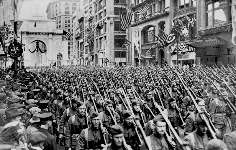 ". The First Battalion of he 308th Infantry, the famous ""Lost Battalion\"" of the 77th Division\'s Argonne campaign of the Great War, march up New York\'s Fifth Avenue just past the Arch of Victory during spring of 1919. (AP Photo)"