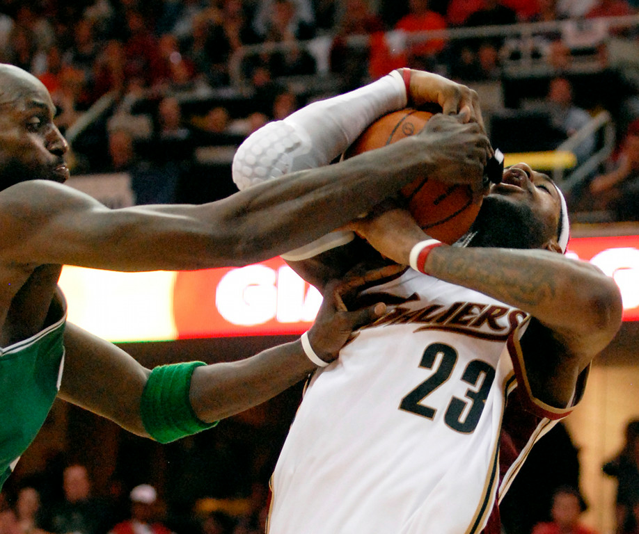 . Jeff Forman/JForman@News-Herald.com Kevin Garnett fouls LeBron James during the second half of the Cavalier\'s win over the Celtics in game one of the eastern conference semifinal series Saturday at Quicken Loans Arena.
