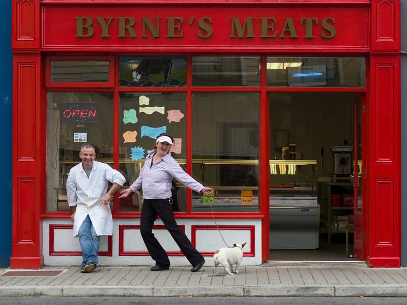 Couple posing outside a butcher shop, Kiltimagh, County Mayo, Republic of Ireland