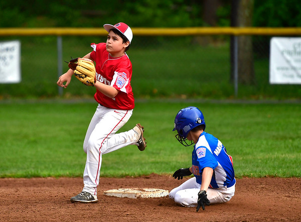 6/25/2019 Mike Orazzi | Staff Forestville's Aiden Smith (2) as Wallingford's Michael Mastroianni (1) slides into second during Tuesday's baseball game in Bristol.