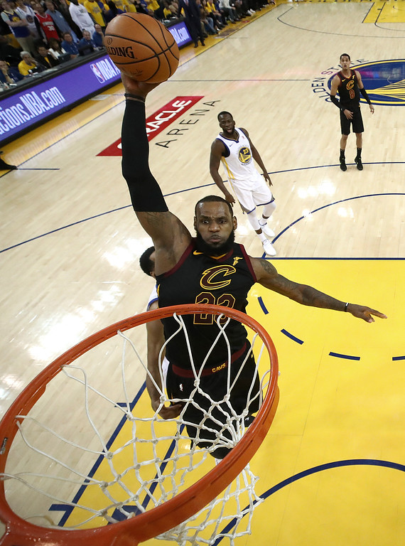 . Cleveland Cavaliers forward LeBron James dunks against the Golden State Warriors during the second half of Game 1 of basketball\'s NBA Finals in Oakland, Calif., Thursday, May 31, 2018. The Warriors won 124-114 in overtime. (Ezra Shaw/Pool Photo via AP)