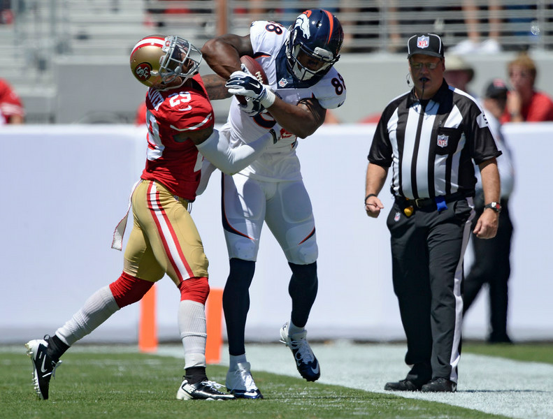 . San Francisco 49ers defensive back Chris Culliver (29) shoves Denver Broncos wide receiver Demaryius Thomas (88) out of bounds after picking up a few yards during the first quarter August 17, 2014 at Levi\'s Stadium. (Photo by John Leyba/The Denver Post)