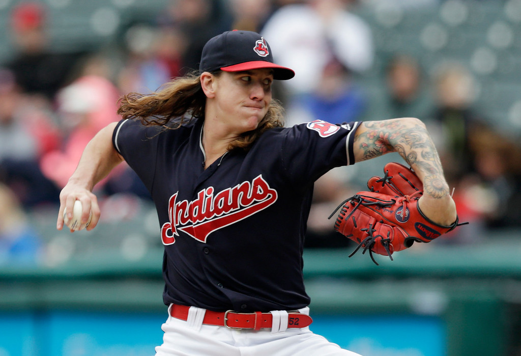 . Cleveland Indians starting pitcher Mike Clevinger delivers in the first inning of a baseball game against the Kansas City Royals, Saturday, May 12, 2018, in Cleveland. (AP Photo/Tony Dejak)