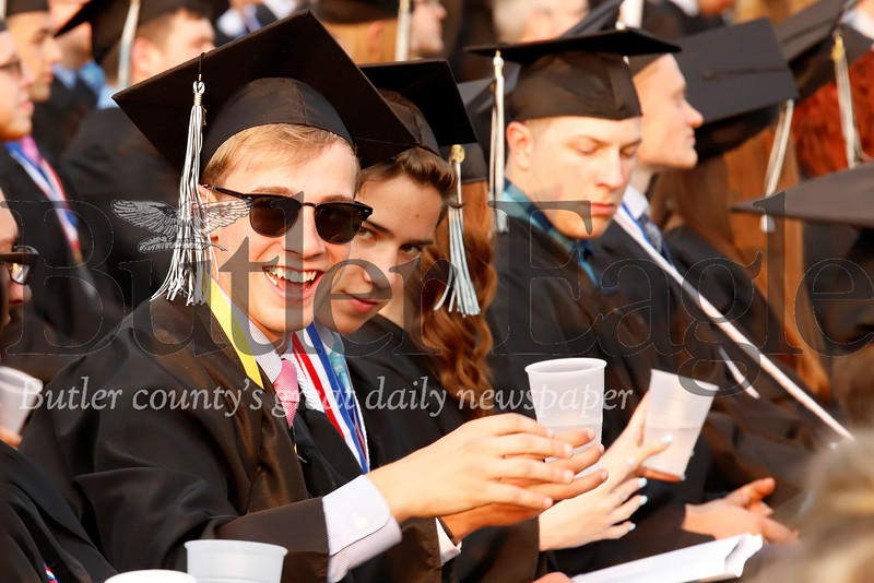 Seneca class of 2019 graduates stay hydrated during Friday night's outdoor ceremony. Seb Foltz/Butler Eagle