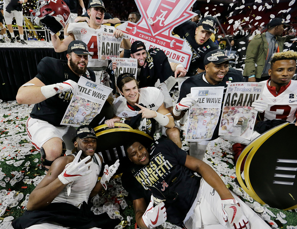 . Alabama players celebrate after overtime of the NCAA college football playoff championship game against Georgia Monday, Jan. 8, 2018, in Atlanta. Alabama won 26-23. (AP Photo/David J. Phillip)