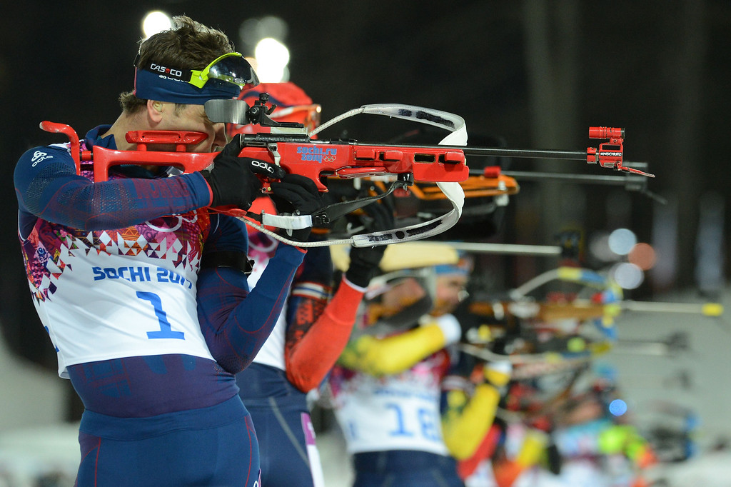 . Norway\'s Ole Einar Bjoerndalen shoots as he competes in the Men\'s Biathlon 12,5 km Pursuit at the Laura Cross-Country Ski and Biathlon Center during the Sochi Winter Olympics on February 10, 2014 in Rosa Khutor near Sochi.   KIRILL KUDRYAVTSEV/AFP/Getty Images