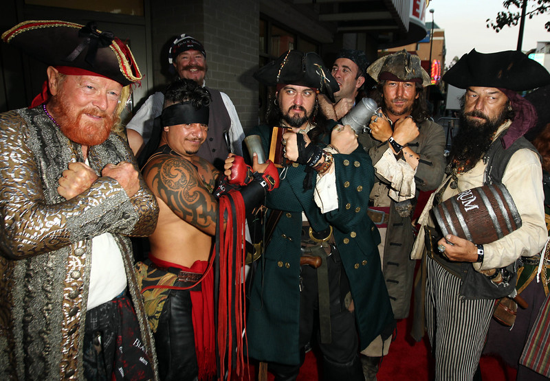 ". Fans dressed as pirates pose together before the fan sneak peek screening of ""Black Sails\"" during San Diego Comic-Con on Thursday, July 18, 2013 in San Diego, Calif. \""Black Sails\"" premieres on STARZ January 2014. (Photo by Matt Sayles/Invision for STARZ/AP Images)"