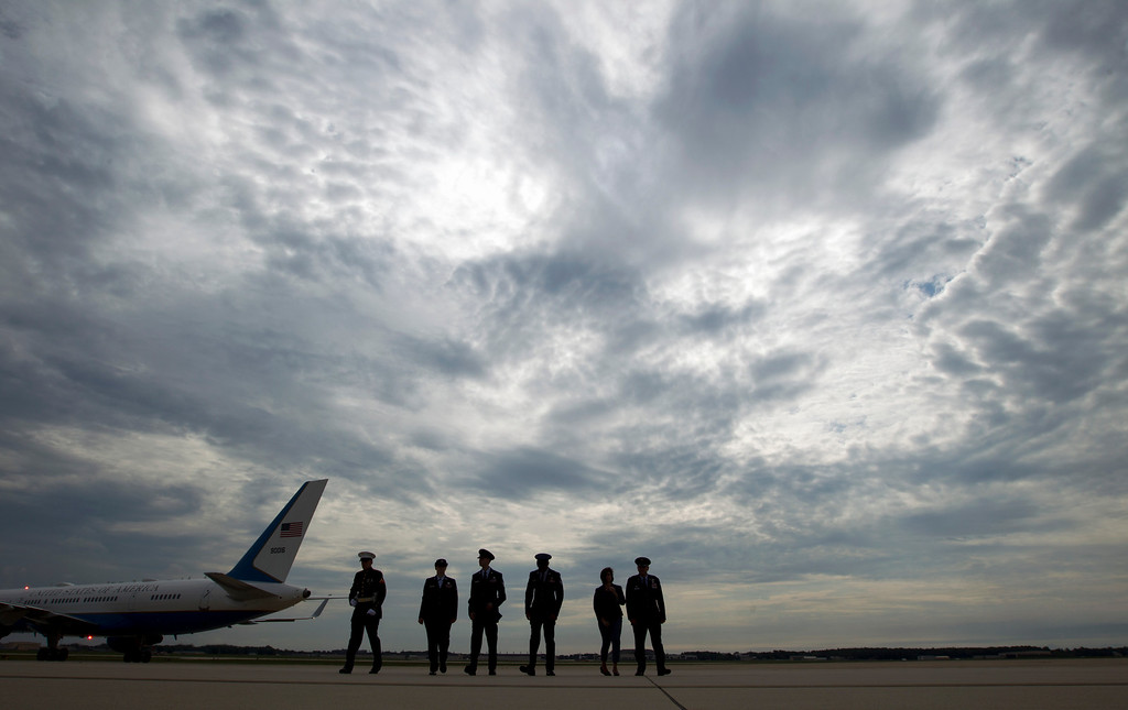 . Military personnel walks out of the fly line as Air Force One with President Barack Obama aboard departs from Andrews Air Force Base, Md., Saturday, June 6, 2015, as they travel to Wilmington, Del. to attend funeral services for Vice President Joe Biden\'s son, former Delaware Attorney General Beau Biden, the vice presidentís eldest son. Biden died of brain cancer at the age 46. (AP Photo/Jose Luis Magana)